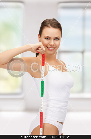 young beautiful woman with measure tape stock photo, picture of young beautiful woman with measure tape by Syda Productions