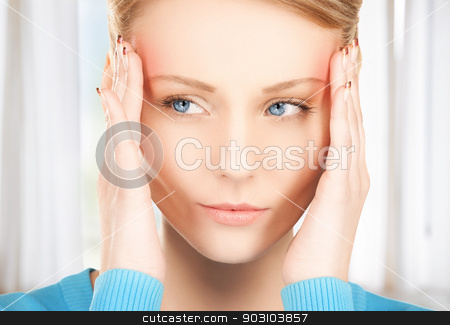 unhappy woman stock photo, unhappy woman holding her head with hands by Syda Productions