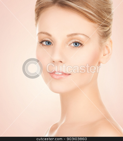 beautiful woman with updo hair stock photo, face of beautiful woman with updo hair by Syda Productions