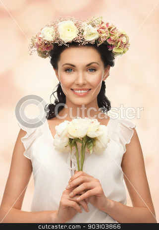 woman wearing wreath of flowers stock photo, young woman wearing wreath of flowers and bouquet by Syda Productions