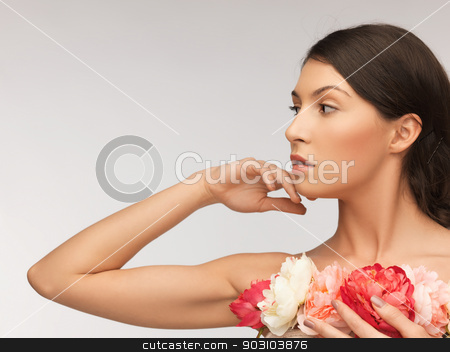 relaxed woman with flowers stock photo, bright picture of relaxed woman with flowers. by Syda Productions