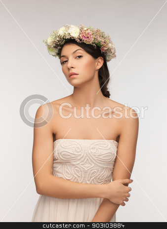 woman wearing wreath of flowers stock photo, picture of young woman wearing wreath of flowers . by Syda Productions