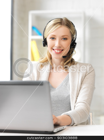 friendly female helpline operator with laptop stock photo, smiling female helpline operator with headphones and laptop by Syda Productions
