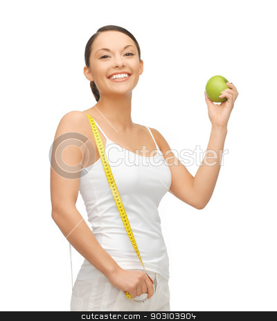 sporty woman with apple and measuring tape stock photo, beautiful sporty woman with apple and measuring tape by Syda Productions