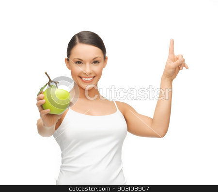 woman with green apple pointing her finger up stock photo, beautiful woman with green apple pointing her finger up. by Syda Productions