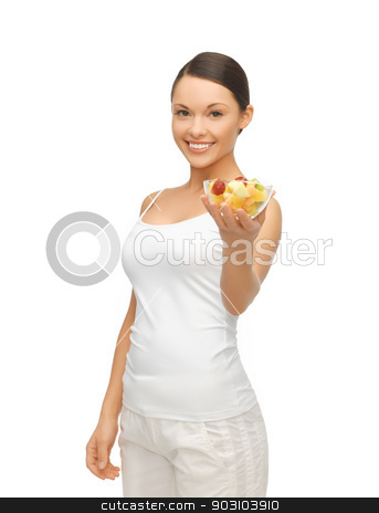 healthy woman holding bowl with fruit salad stock photo, picture of healthy woman holding bowl with fruit salad by Syda Productions