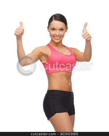 beautiful sporty woman stock photo, picture of beautiful sporty woman showing thumbs up by Syda Productions