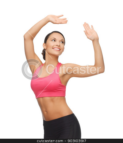 sporty woman in aerobic or dance movement stock photo, beautiful sporty woman in aerobic or dance movement by Syda Productions