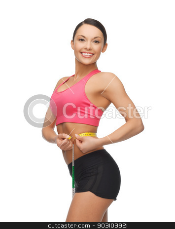 sporty woman with measuring tape stock photo, beautiful sporty woman with measuring tape by Syda Productions