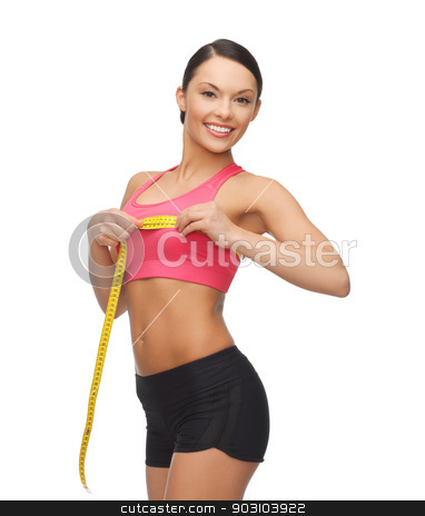 sporty woman measuring her breast stock photo, picture of beautiful sporty woman measuring her breast by Syda Productions