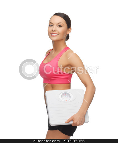 woman with scale stock photo, picture of beautiful sporty woman with scale by Syda Productions