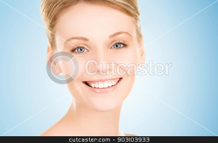 lovely woman stock photo, bright picture of lovely woman over blue by Syda Productions