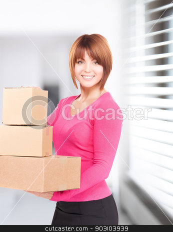 businesswoman with parcels stock photo, picture of businesswoman with parcels in office by Syda Productions