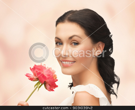 young and beautiful woman with flower stock photo, picture of young and beautiful woman with flower by Syda Productions