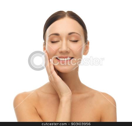 beautiful woman touching her skin stock photo, face of beautiful woman touching her skin by Syda Productions