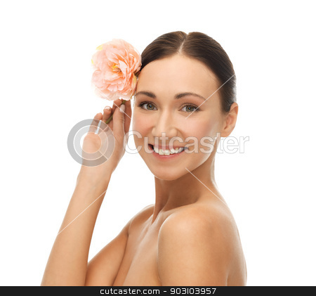 smiling woman with flowers stock photo, bright picture of smiling woman with flower. by Syda Productions