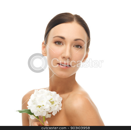 beautiful woman with white flower stock photo, portrait of beautiful woman with white flower by Syda Productions