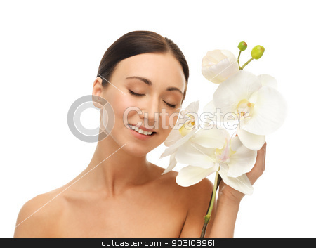 smiling woman with white orchid flower stock photo, bright picture of smiling woman with white orchid flower. by Syda Productions