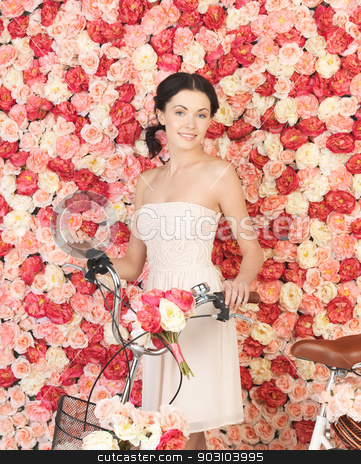 woman with bicycle and background full of roses stock photo, young woman with bicycle and background full of roses by Syda Productions