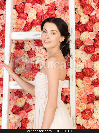 woman with old ladder and background full of roses stock photo, young woman with old ladder and background full of roses by Syda Productions