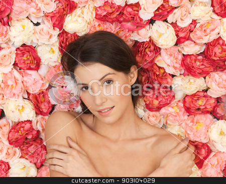 beautiful woman and background full of roses stock photo, face of beautiful woman and background full of roses by Syda Productions