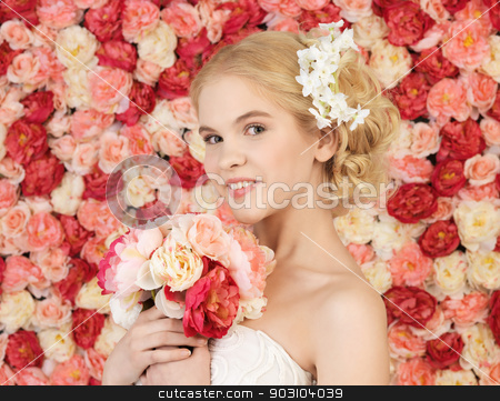 woman with bouquet and background full of roses stock photo, woman with bouquet of flowers and background full of roses by Syda Productions