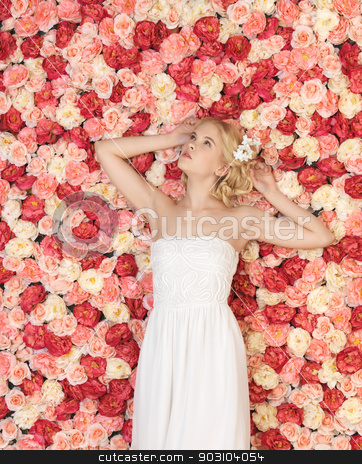 young woman with background full of roses stock photo, beautiful and young woman with background full of roses by Syda Productions