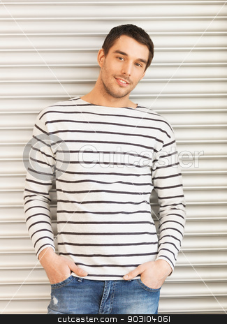 handsome man in casual clothes leaning to wall stock photo, portrait of handsome man in casual clothes leaning to wall by Syda Productions