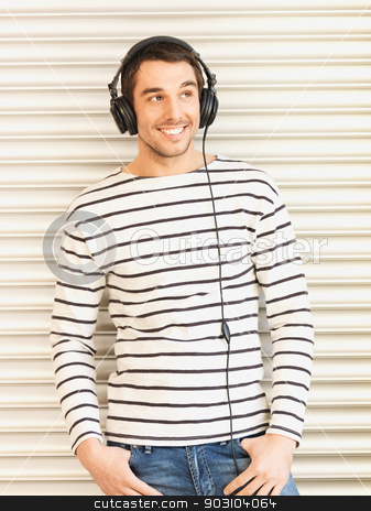 man in casual clothes with headphones stock photo, handsome man in casual clothes with headphones by Syda Productions