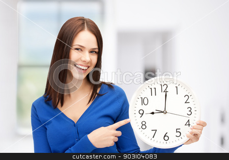 woman holding big clock stock photo, bright picture of woman holding big clock by Syda Productions