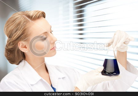 lab worker holding up test tube stock photo, picture of beautiful lab worker holding up test tube by Syda Productions