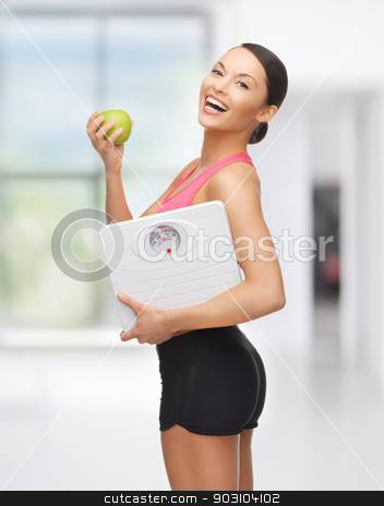 sporty woman with scale and green apple stock photo, picture of beautiful sporty woman with scale and green apple by Syda Productions