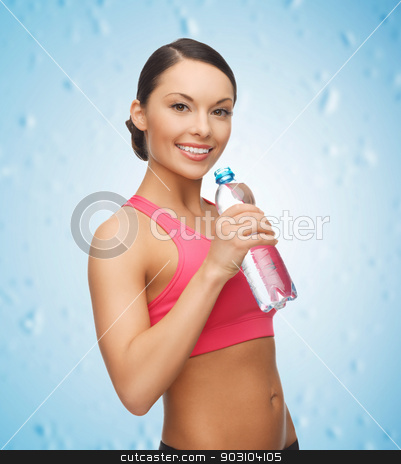 sporty woman drinking water from bottle stock photo, picture of sporty woman drinking water from bottle by Syda Productions