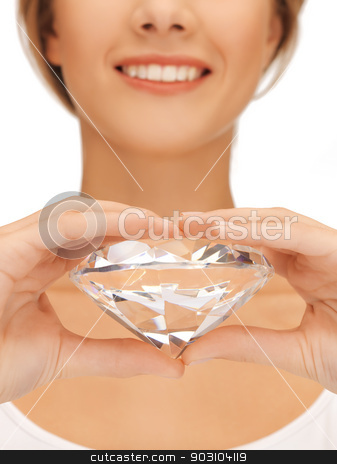 woman's hands showing big diamond stock photo, close-up of woman's hands showing big diamond by Syda Productions