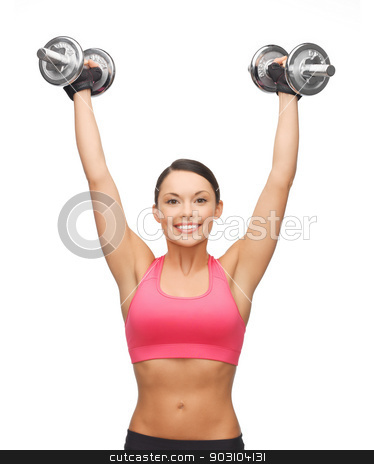woman with heavy steel dumbbells stock photo, picture of young sporty woman with heavy steel dumbbells by Syda Productions