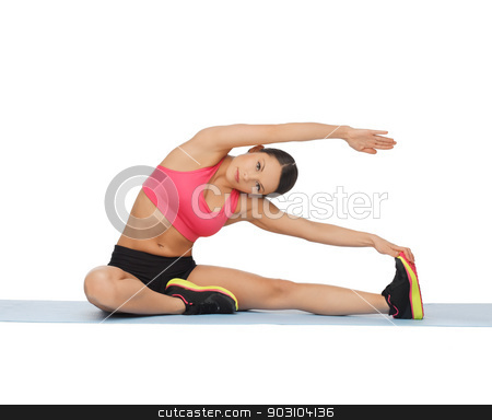 sporty woman doing exercise on the floor stock photo, beautiful sporty woman doing exercise on the floor by Syda Productions