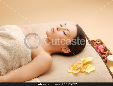 woman in spa salon lying on the massage desk stock photo, picture of woman in spa salon lying on the massage desk by Syda Productions
