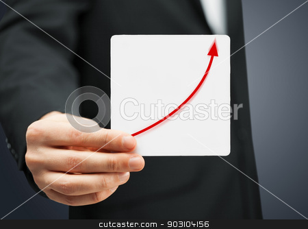 card with increasing graph on it stock photo, man in suit holding card with increasing graph on it by Syda Productions
