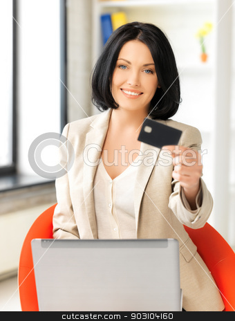 businesswoman with laptop showing credit card stock photo, smiling businesswoman with laptop showing credit card by Syda Productions