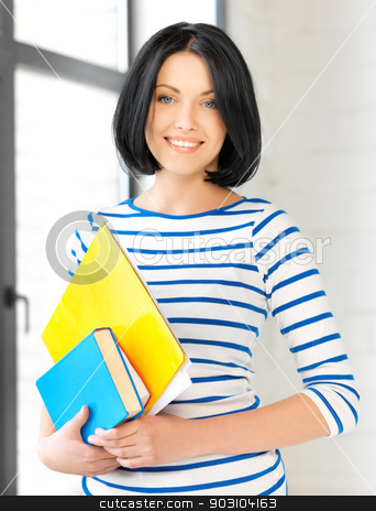 smiling student with books and notes stock photo, picture of smiling student with books and notes by Syda Productions