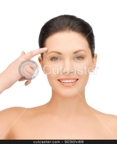 beautiful woman touching her forehead stock photo, face of beautiful woman touching her forehead by Syda Productions