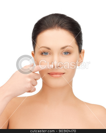 woman touching her nose stock photo, face of beautiful woman touching her nose by Syda Productions