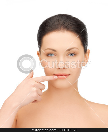 woman touching her lips stock photo, face of beautiful woman touching her lips by Syda Productions