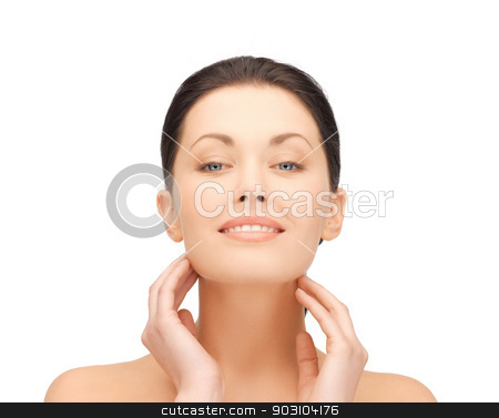 woman touching her face stock photo, portrait of beautiful woman touching her face by Syda Productions