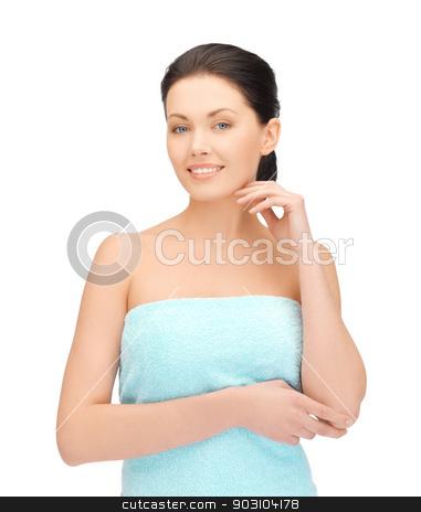 beautiful woman meditating in towel stock photo, bright picture of beautiful woman in towel by Syda Productions
