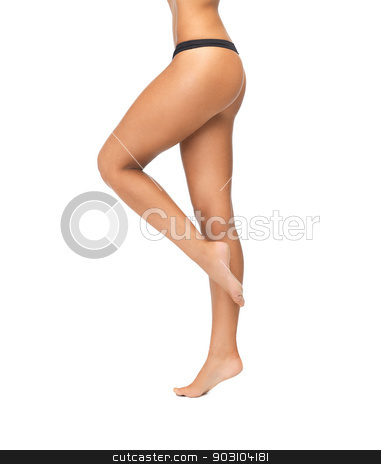 female legs in black bikini panties stock photo, female legs in black bikini panties standing on one leg by Syda Productions