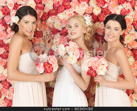 three women with background full of roses stock photo, beautiful three women with background full of roses by Syda Productions