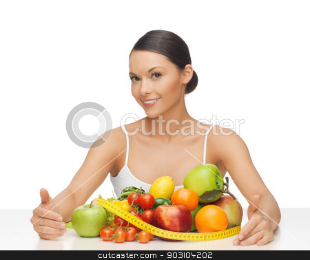 woman with measuring tape and lots of fruits stock photo, healthy woman with measuring tape and lots of fruits by Syda Productions