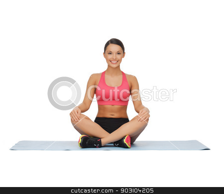 beautiful young woman practising yoga stock photo, picture of beautiful young woman practising yoga by Syda Productions
