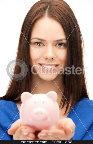 lovely woman with small piggy bank stock photo, picture of lovely woman with small piggy bank by Syda Productions